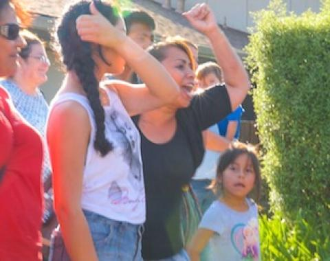 Renters and community supporters protest the eviction of residents of 1824 El Parque Court in San Mateo at a vigil organized by the San Francisco Organizing Project/Peninsula Interfaith Action. Courtesy of [people.power.media].